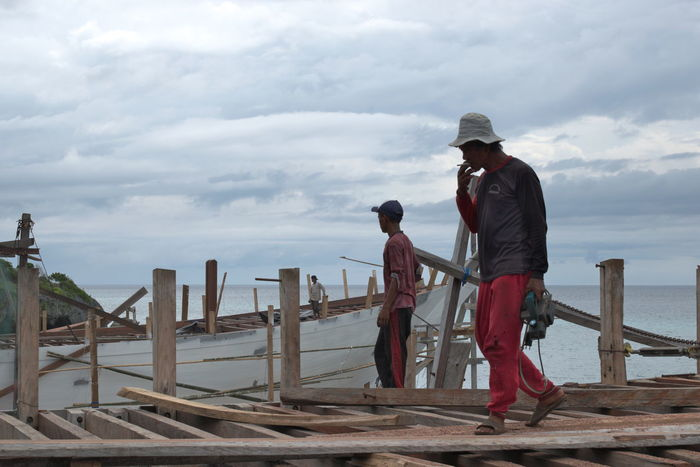 Traditional shipbuilding in Bira Bulukumba, South Sulawesi. Bira Boat Bulukumba Craft Craftsmanship  Dock Dockyard Makassar Making Ship Men Phinisi Ship Ship Making Shipbuilders Shipbuilding Shipbuilding Yard Shipmakers Shipyard Sulawesi Traditional Wooden Ship Work Working Hard