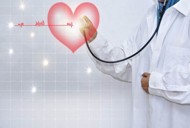 Female doctor isolated on white background checking your heartbeat with stethoscope. Doctor  Heartbeat Moments Adult Care Clothing Concept Doctor  Emotion Female Healthcare And Medicine Heart Shape Heart ❤ Holding Human Body Part Human Limb Indoors  Lab Coat Love Medical Equipment Medical Instrument Medical Supplies Occupation One Person Positive Emotion Stethoscope