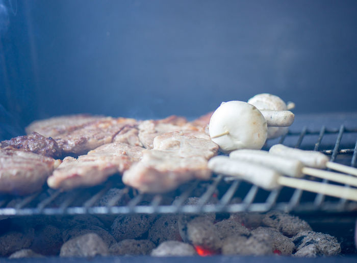 Close-up Of Meat With Mushrooms On Barbeque
