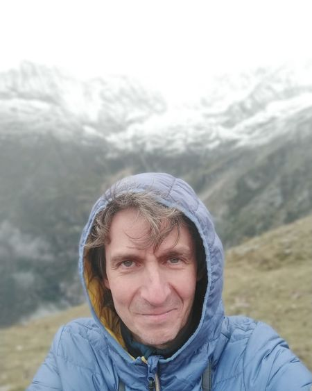 Portrait of mid adult man in snow