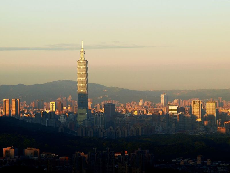 The first light of day reaches the buildings of Taipei city. Skyscrapers Taipei 101 Taiwan Architecture Building Exterior Built Structure City Cityscape Dawn Day First Light Illuminated Modern No People Outdoors Sky Skyline Skyscraper Sunset Tall Tower Travel Destinations Urban Skyline