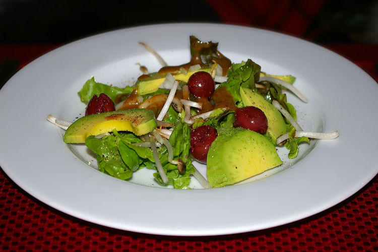 Homemade avocado salad with bean sprouts and cherries Food And Drink Food Ready-to-eat Healthy Eating Plate Freshness Vegetable Wellbeing Indoors  Close-up Salad Serving Size No People Still Life Table Green Color Indulgence Red Lettuce Garnish Homemade Avocado Cherry Blossom Bean Sprouts