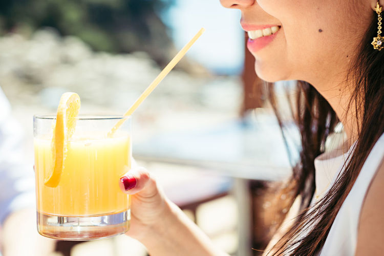Alcohol Close-up Cocktail Day Drink Drinking Glass Drinking Straw Focus On Foreground Food Food And Drink Freshness Holding Human Hand Leisure Activity Lifestyles One Person Outdoors People Real People Refreshment Tropical Drink Young Adult Young Women