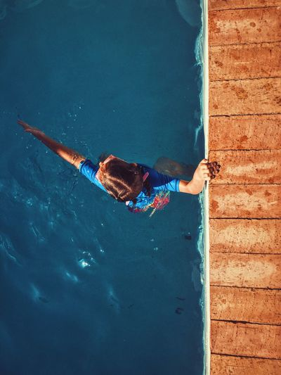 High angle of young girl in swimming pool