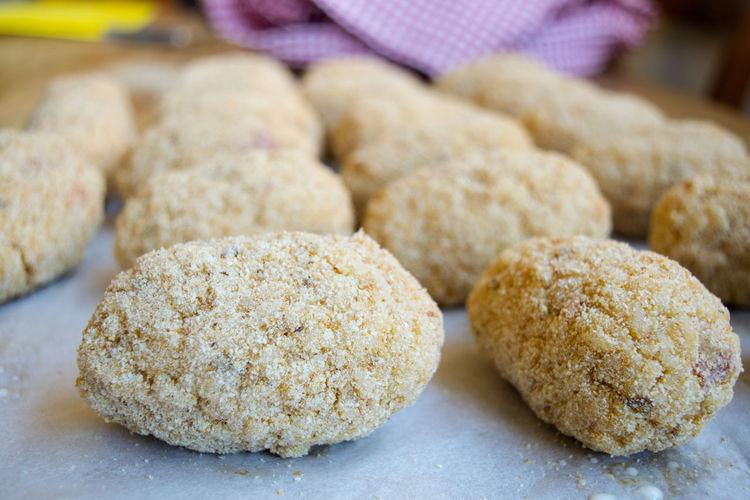 preparing fried rice balls or arancini Rice Arancini Ball Croquette Fried Preparing Raw Rice