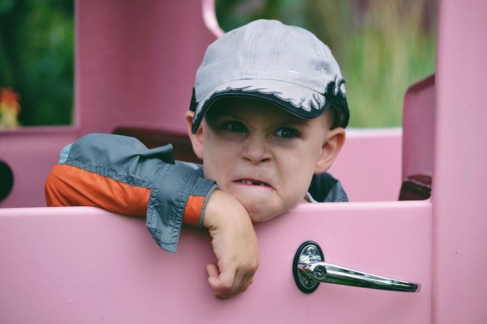 Boy with a funny face Real People Childhood Boys One Person Leisure Activity Focus On Foreground Elementary Age Headshot Lifestyles Front View Headwear Day Portrait Close-up Indoors  Baseball Helmet Boy Child Funny Funny Face Facial Expression Cute People Kid Kids Being Kids