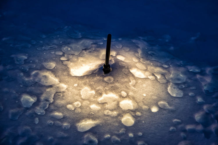 Light under the snow Water No People Lighting Equipment Nature Blue Illuminated Cold Temperature Wet Winter Light Indoors  High Angle View Close-up Single Object Electric Light Glowing Frozen Electricity  Melting Long Exposure Snow Lamp Light Night Alps Tyrol Austria Winter