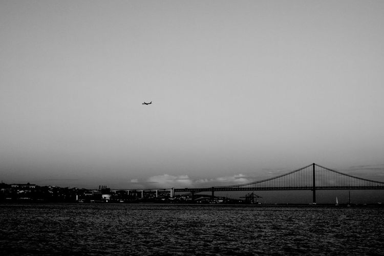 Flying Sky Air Vehicle Airplane Outdoors Transportation Mid-air Sea Clear Sky City Bridge Over Water Bridge - Man Made Structure Bridge Tejo Tejo River Black And White City Blackandwhite Black & White Blackandwhite Photography Lisbao Lisbon Transportation Architecture_collection Architecture Black And White Friday Go Higher