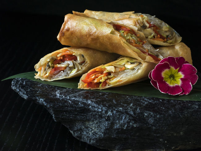 Asian-style Pancakes crunchy with vegetable filling, served on slate Asian  Asian-style Black Black Background Close-up Crunchy Filling Flower Food Food And Drink Freshness Indoors  No People Pancakes Ready-to-eat Red Served Slate Stone Studio Shot Style Vegan Vegetable Vegeterian