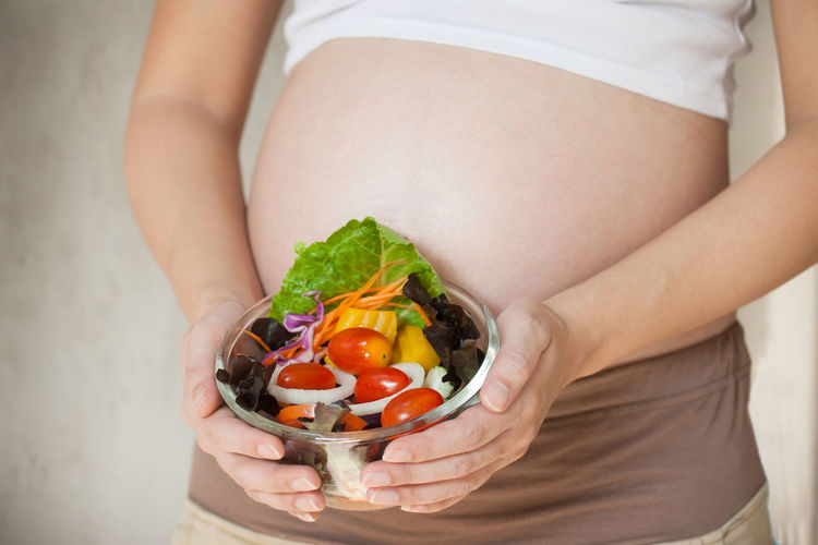 Pregnant Woman Adult Anticipation Beginnings Belly Food Food And Drink Freshness Hand Healthy Eating Healthy Lifestyle Holding Human Abdomen Human Body Part Indoors  Lifestyles Midsection One Person Pregnant Pregnant Belly  Vegetable Wellbeing Women