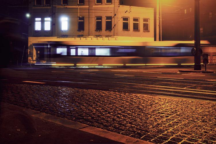 Train on railroad track at night