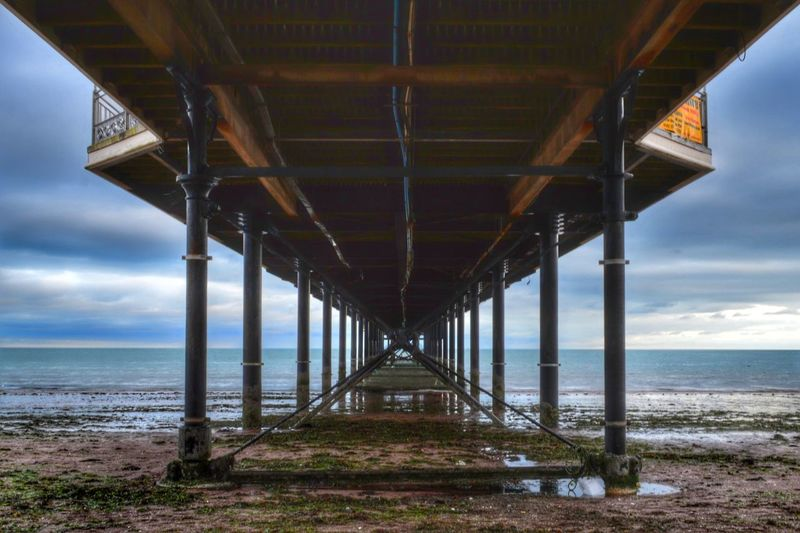Low angle view of paignton pier at beach