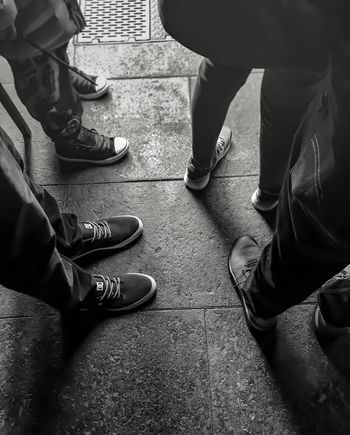 Surrounded by people but still alone..... Lgarciaphoto IPhone IPhone 7 Plus IPhoneography Shot On IPhone Iphoneonly Monochrome Blackandwhite Universal Studios  Hollywood Shoe Low Section Human Leg Real People Standing Lifestyles Human Body Part Casual Clothing Men Personal Perspective Leisure Activity Canvas Shoe Day Outdoors Hollyweed