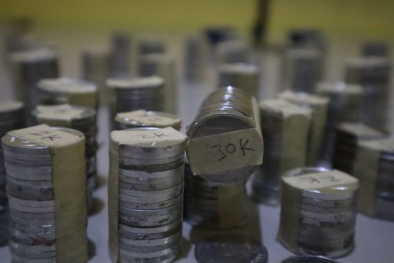 Stacks on coins on table