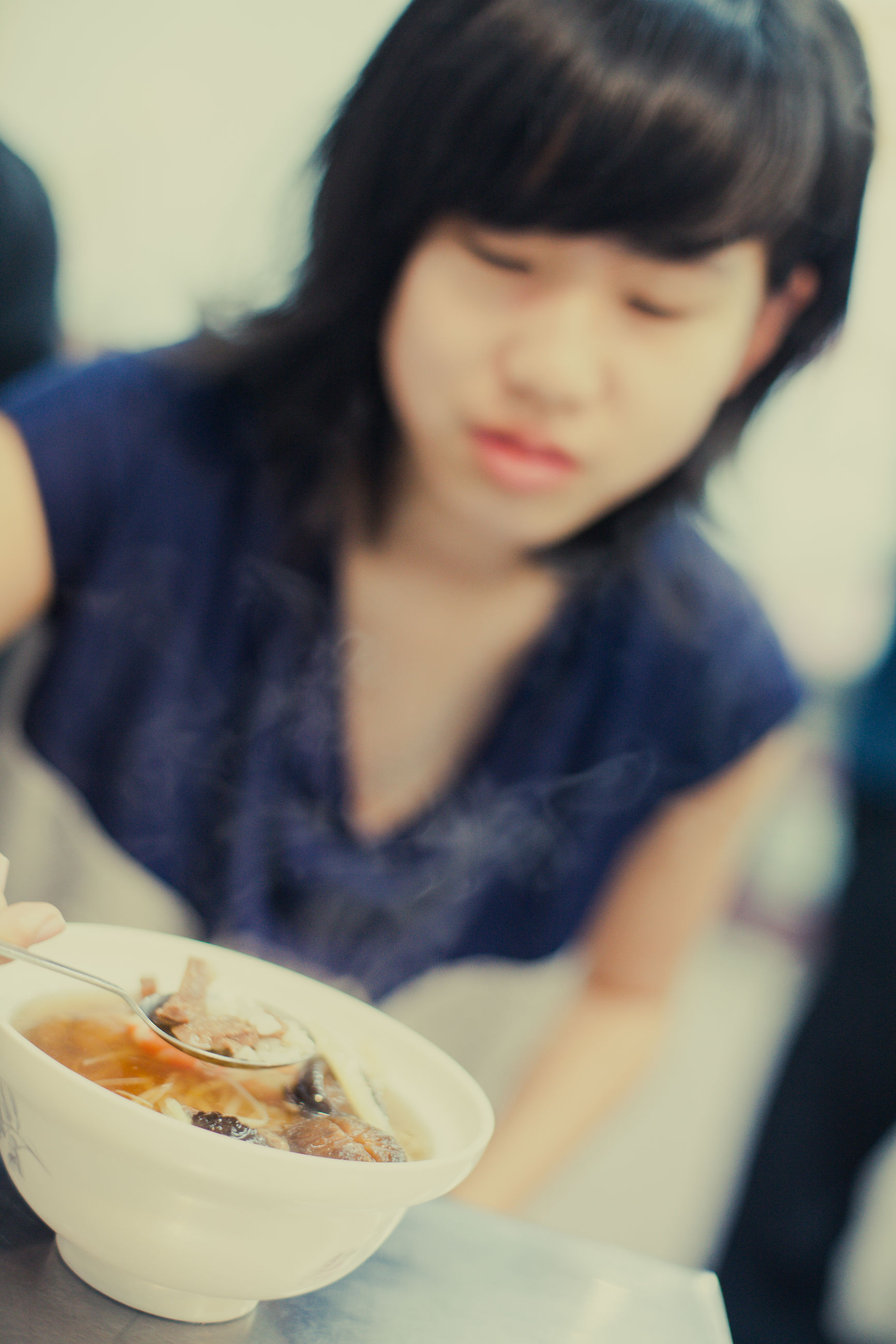 food, food and drink, one person, indoors, child, table, real people, childhood, bowl, focus on foreground, freshness, selective focus, women, ready-to-eat, front view, meal, lifestyles, close-up, girls, breakfast, hairstyle