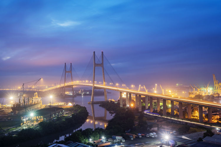 Illuminated phu my bridge over river against sky