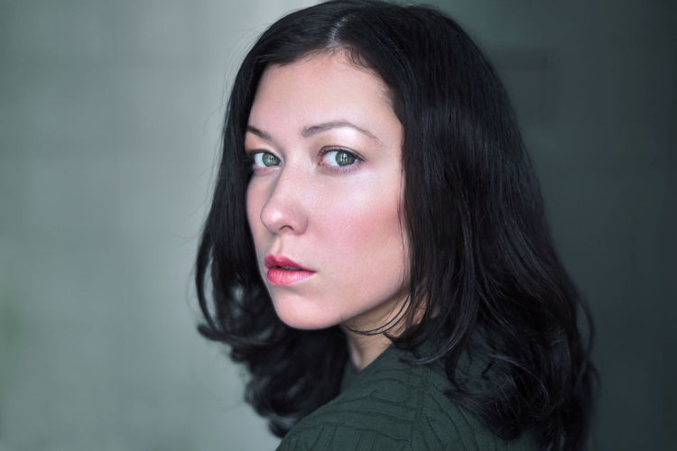 Adult Beautiful Woman Beauty Black Hair Close-up Day Focus On Foreground Gray Background Green Eyes Headshot Long Hair Looking At Camera One Person One Woman Only Only Women People Portrait Smiling Young Adult