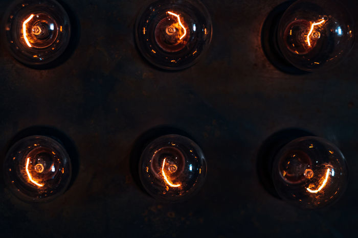 incandescent bulbs Backgrounds Burning Close-up Dark Electricity  Fire Fire - Natural Phenomenon Flame Full Frame Glowing Heat - Temperature Illuminated In A Row Incandescent Incandescent Bulbs Indoors  Lighting Equipment No People Orange Color Side By Side Technology