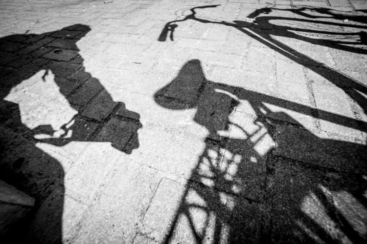 The shadow photographer Shadow High Angle View Sunlight City Focus On Shadow Nature Day Street Transportation Road Group Of People People Outdoors Men Real People Representation Leisure Activity Lifestyles Low Section Human Body Part Paving Stone
