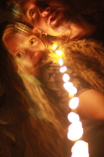 Close-up portrait of illuminated mother