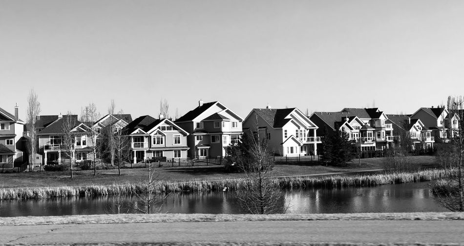 Man Made Lake Built Structure Building Exterior Sky Architecture Water Building Copy Space House Day Reflection Row House City