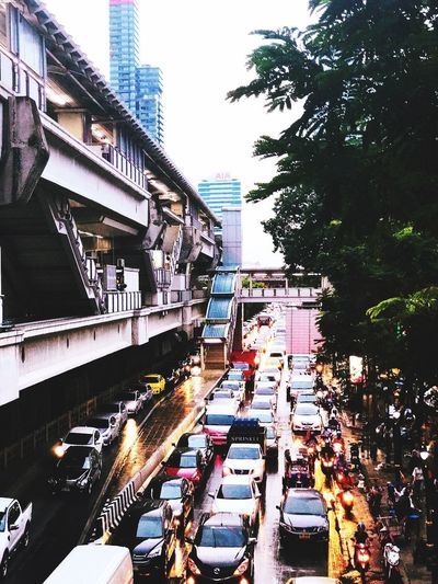 Traffic jam Architecture City Street Car City Street Building Exterior City Life Built Structure Day Outdoors Tree Transportation Road Real People Crowd People Sky Adult