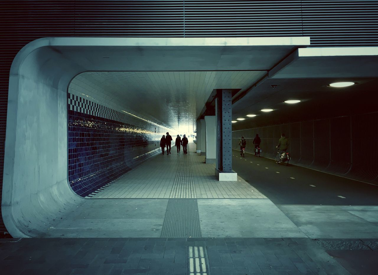 People In Tunnel
