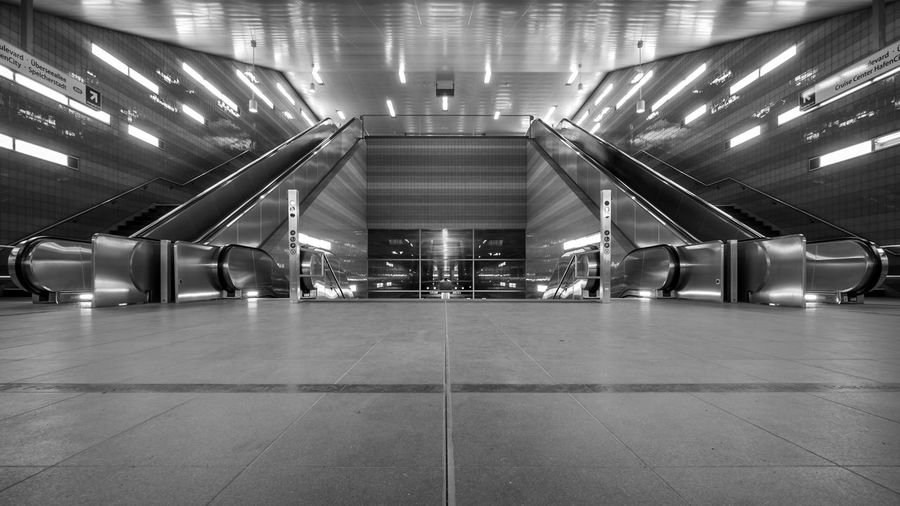 Hamburg Subway Station in Black and White Architecture Black And White Blackandwhite Photography Built Structure Ceiling Day Empty Escalator Flooring Futuristic Illuminated Indoors  Light And Shadow Lighting Equipment Modern No People Public Transportation Subway Station Subway Train Subwayphotography Subwaystation The Way Forward Transportation Transportation Building - Type Of Building Underground EyeEmNewHere Stories From The City