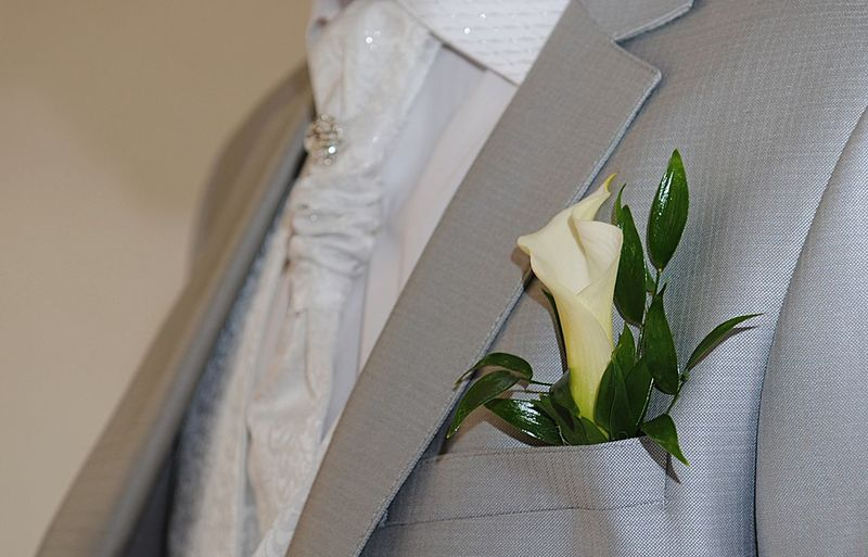 Groom's suit close-up with a bouquet of flowers in his pocket,white shirt