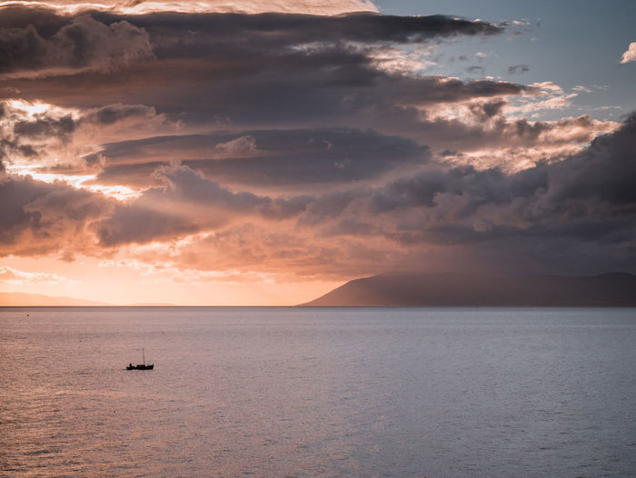 Small boat on sea at sunset Adriatic Beauty In Nature Boat Cloud - Sky Croatia Day Dramatic Sky Horizon Over Water Island Landscape Marine Mediterranean  Nature No People Outdoor Outdoors Scenic Scenics Sea Sky Small Sunlight Sunset Vessel Water