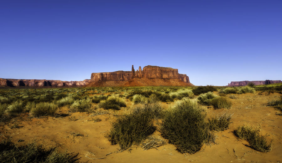 Monument Valley is a scene of beauty and many western style movies Scenics - Nature Nature No People Monument Valley Tribal Park Park Rocks Mountains Desert Adventure Movie Films John Wayne Travel Destinations Travel Photography Nature Nature Photography Hiking Camping Landscape Landscape Photography Color Three Sisters