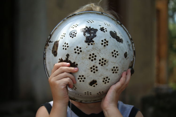 Woman Holding Colander