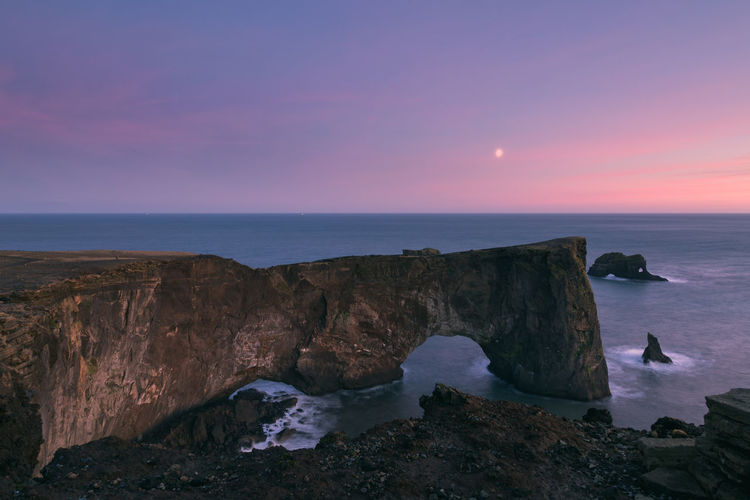 Dyrhólaey at sunset in moonlight Sea Water Rock Sky Solid Rock - Object Horizon Horizon Over Water Scenics - Nature Nature Beauty In Nature Sunset Land Beach Tranquility Tranquil Scene Dusk Rock Formation Seascape Outdoors Rock Formation Moody Sky Moonlight Travel Goals Wanderlust Nature