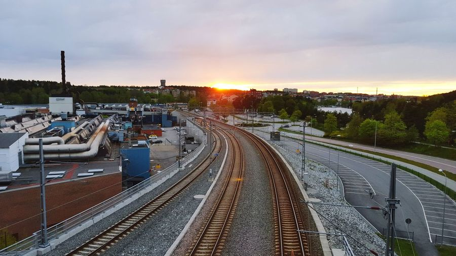 Sunset in my hometown Södertälje. Part of Scania factory on the left, new 3-track rails for better train traffic from Stockholm Sunset Railroad Södertälje Scania My City