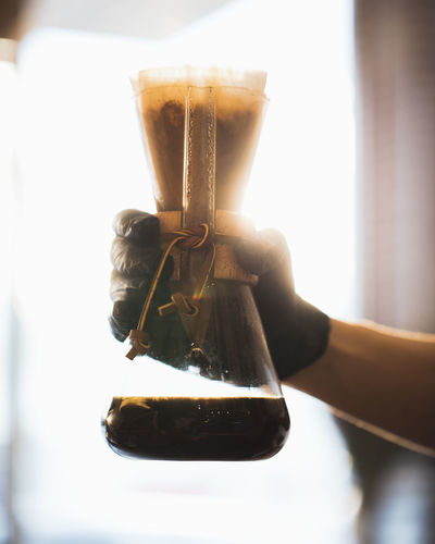 Black Coffee inside Lab Glass in Hand Ijas Muhammed Photography Drink Food And Drink Refreshment Close-up Coffee - Drink Coffee Holding Indoors  Glass Glass - Material Alcohol Table Focus On Foreground Human Hand Hand Day Human Body Part Container Transparent One Person