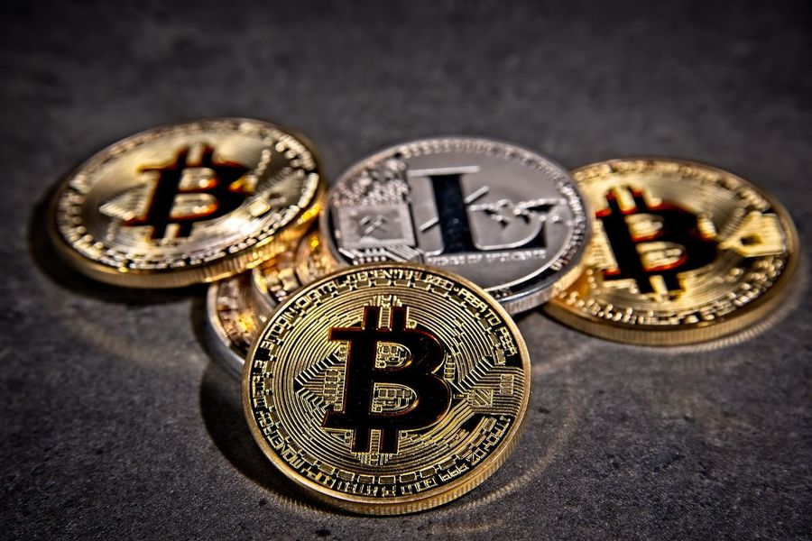 Shining metal BTC bitcoin and litecoin coins on grey background. BTC Deep Web Economy Gold LTC Virtual Bitcoin Blockchain Close-up Coins Crypto Cryptocurrency Cryptography Dark Web Digital Finance Gold Gold Colored Indoors  Litecoin Metal Money No People Trade