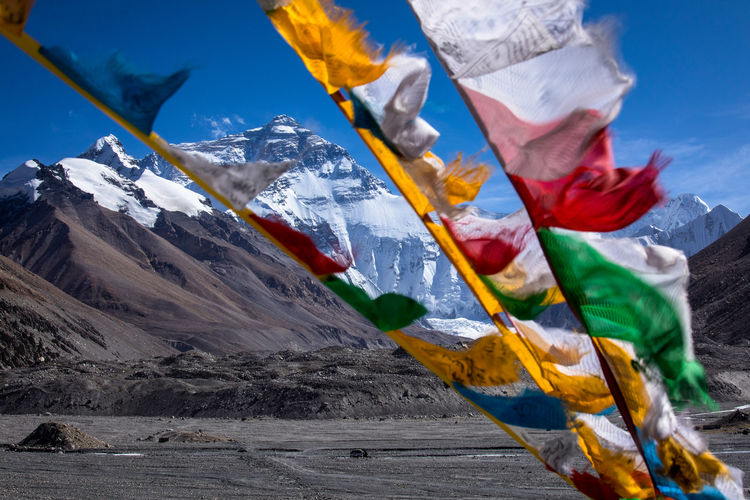 Prayer flags waving against mountains