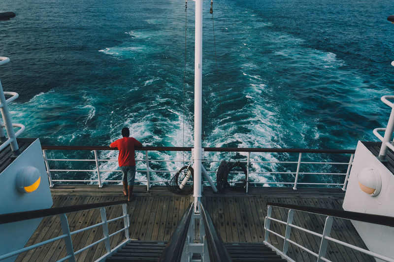 Boat Boy Cruise Cruise Ship Lifestyles Nautical Vessel Ocean Red Rippled Sea Stairs Sunny Symmetry Travel Traveling Turquoise Colored VSCO Water