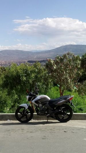 Contraste motor - naturaleza, Cochabamba al fondo... Motorcycle Road Motorsport Sky Cloud - Sky Land Vehicle Parking First Eyeem Photo