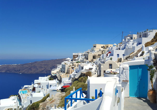 Beautiful white traditional local houses in Santorini island - Greece Island Life Blue Lagoon Mediterranean Culture Panoramic View Resorts Santorini, Greece Scenic Landscapes Summer Views Tourism Turistic Attractions Vacation Time Village Photography White Houses