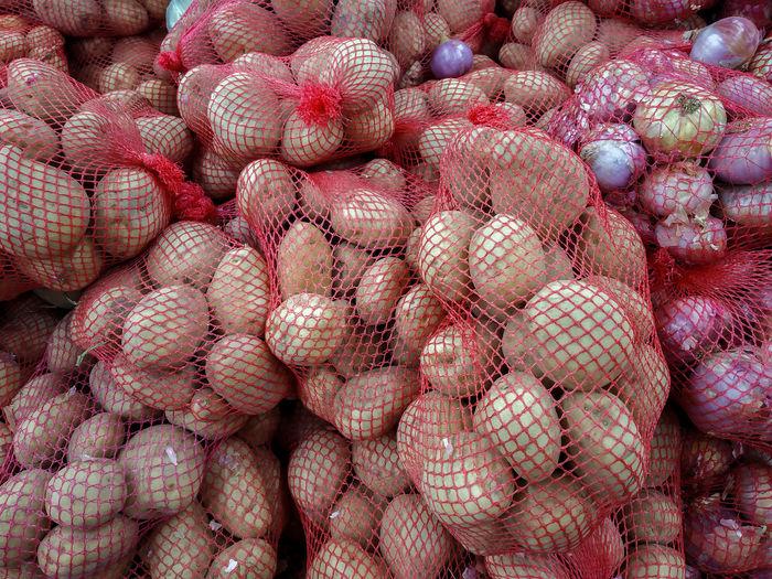 Full frame shot of potato for sale in market
