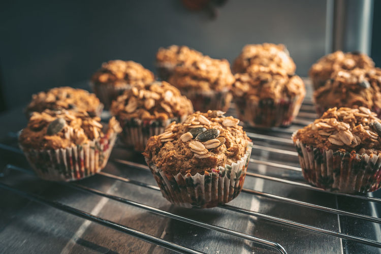 Close-up of muffins on rack