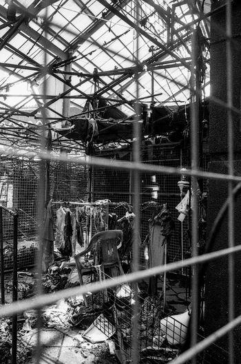 Ferris wheel in cage seen through glass