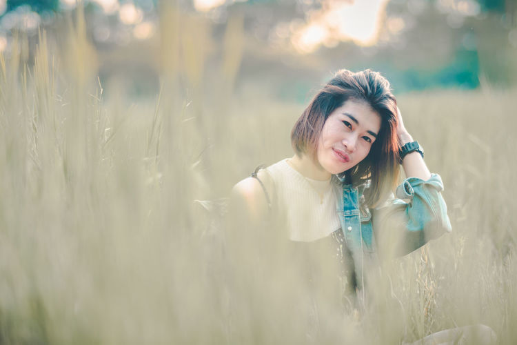Beautiful Woman Day Front View Hairstyle Happiness Land Leisure Activity Lifestyles Looking At Camera Nature One Person Portrait Real People Selective Focus Smiling Women Young Adult
