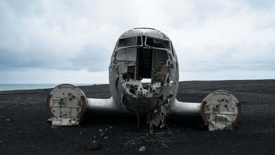 looks broken Iceland Wreck Abandoned Adventure Airplane Black Broken Damaged Metal Military Airplane Sand Silver  Fresh On Market 2018