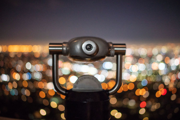 Coin-Operated Binoculars Against Illuminated Lights