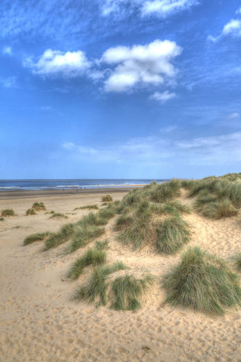 Beach Beauty In Nature Cloud - Sky Day Grass Growth Holidays Holkham Beach Horizon Over Water Landscape Marram Grass Nature No People Norfolk Uk Outdoors Sand Sand Dune Scenics Sea Sky Tranquil Scene Tranquility Travel Destinations Water