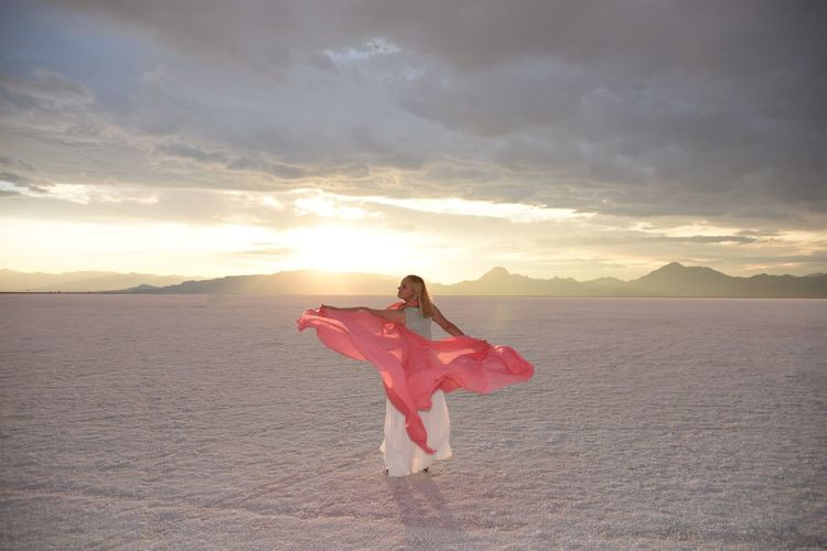 Woman Adult Beautiful Woman Cloud - Sky Day Dreamy Fabric Full Length Nature One Person One Young Woman Only Outdoors People Pink Color Real People Rear View Sand Scenics Silk Sky Standing Sunlight Sunset Young Adult Young Women A New Beginning