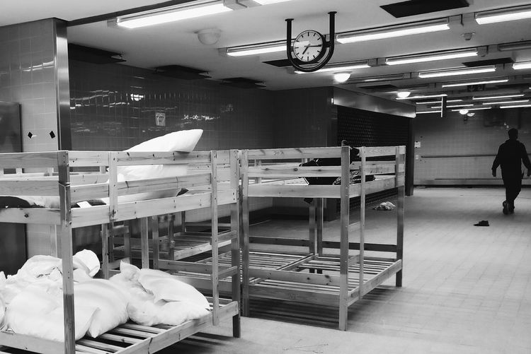 Getting beds ready for refugees at the ICC. One Person Adult Abandoned Places Abandon_seekers Abandoned Perspective Beds Bed Refugeeswelcome ICC Light And Shadow Black And White Collection  Black & White Urbanexploration Hallway Berlin