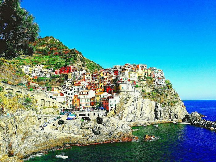 Beautiful town along the Italian coast during summer. Cinque Terra is exquisite. Mobile Mobile Photography P9 Huawei Huawei p9 EyeEmNewHere Coast Beauty Cliffside Peaceful Pituresque Warm Coulourful Coulour Italia Shore Coast Sandy Beach Calm Ocean Beach Sand Scenics Summer Exploratorium